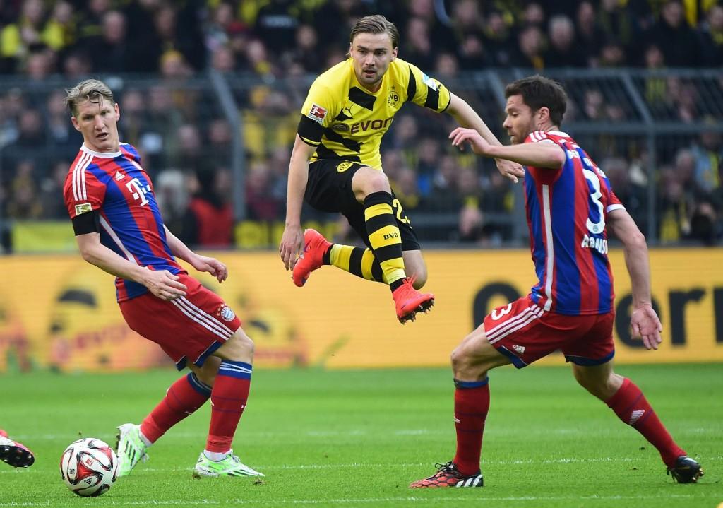 Bastian Schweinsteiger FC Bavaria Munich Marcel Schmelzer Borussia Dortmund Xabi Alonso FC Bavaria Munich