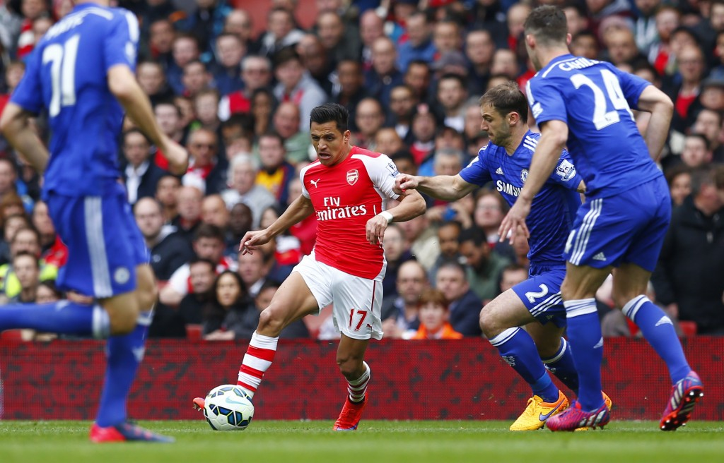 Arsenal's Alexis Sanchez in action with Chelsea's Branislav Ivanovic