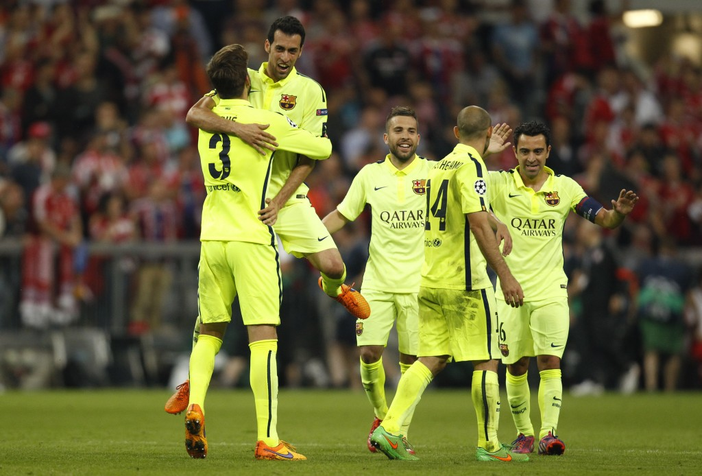 Barcelona's Sergio Busquets, Gerard Pique, Jordi Alba, Javier Mascherano and Xavi celebrate after the game after reaching the UEFA Champions League Final