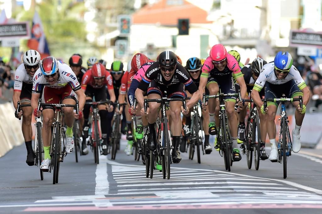John Degenkolb (Team Giant - Alpecin) sprints towards victory before Alexander Kristoff (Team Katusha) and Michael Matthews (Team Orica Greenedge)