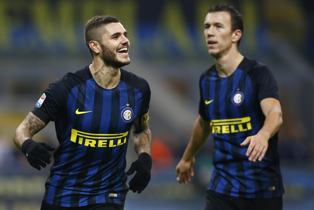 Inter Milan's forward Mauro Emanuel Icardi from Argentina (L) celebrates after scoring with his teammate Inter Milan's forward Ivan Perisic from Croatia during the Italian Serie A football match Inter Milan Vs Crotone on November 6, 2016 at the 'San Siro Stadium' in Milan.  / AFP PHOTO / MARCO BERTORELLO
