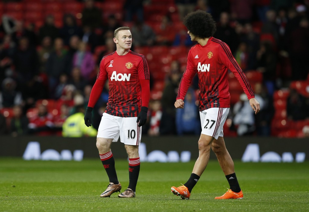 """Football Soccer - Manchester United v Norwich City - Barclays Premier League - Old Trafford - 19/12/15 Manchester United's Wayne Rooney and Marouane Fellaini warm up before the game Reuters / Andrew Yates Livepic EDITORIAL USE ONLY. No use with unauthorized audio, video, data, fixture lists, club/league logos or """"live"""" services. Online in-match use limited to 45 images, no video emulation. No use in betting, games or single club/league/player publications.  Please contact your account representative for further details."""