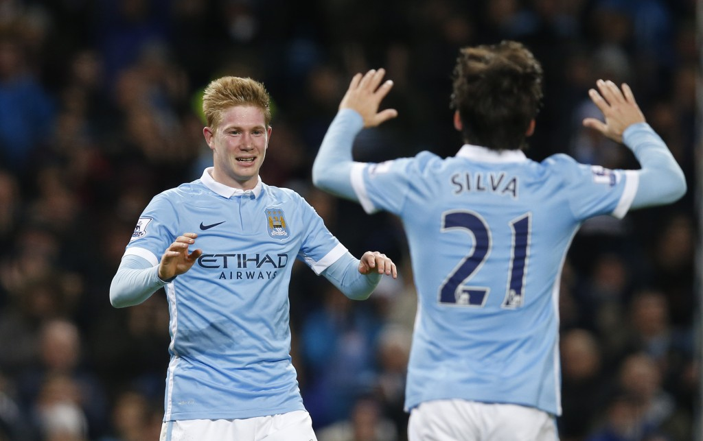"""Football Soccer - Manchester City v Sunderland - Barclays Premier League - Etihad Stadium - 26/12/15 Kevin De Bruyne celebrates with David Silva after scoring the fourth goal for Manchester City Reuters / Andrew Yates Livepic EDITORIAL USE ONLY. No use with unauthorized audio, video, data, fixture lists, club/league logos or """"live"""" services. Online in-match use limited to 45 images, no video emulation. No use in betting, games or single club/league/player publications.  Please contact your account representative for further details."""