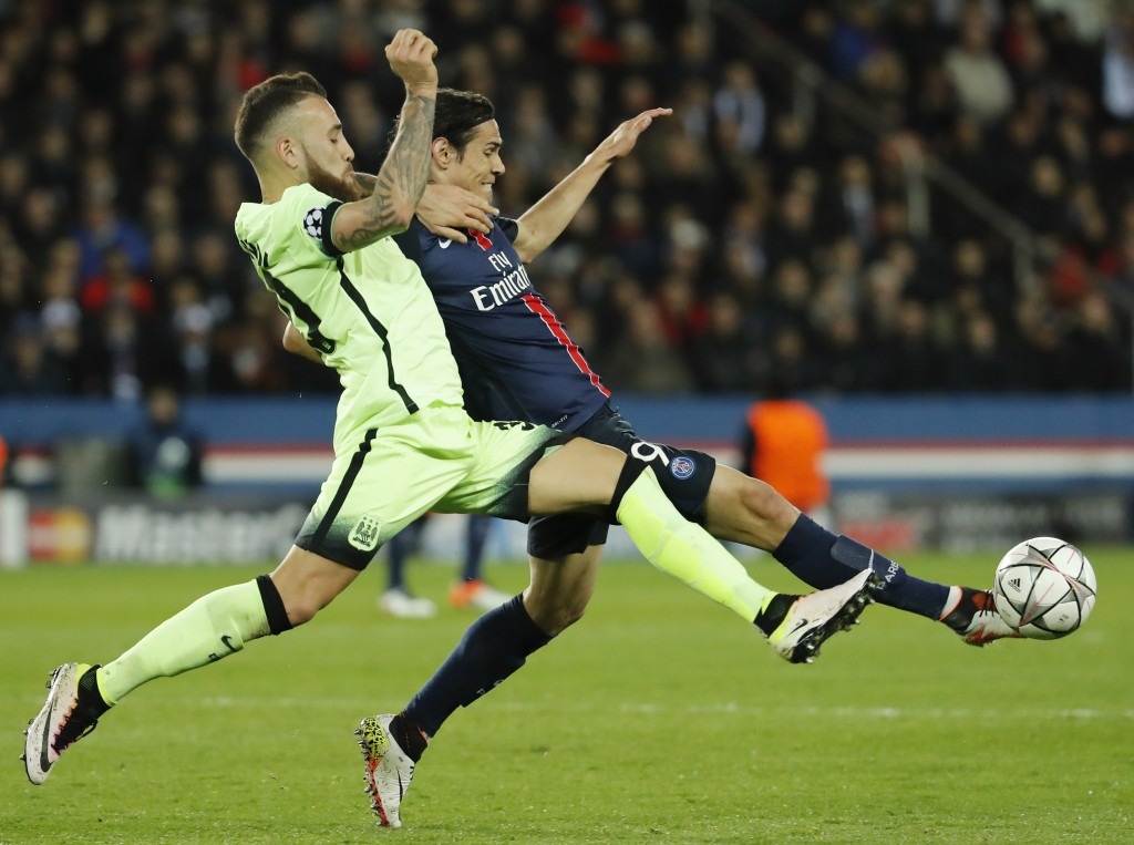 Football Soccer - Paris St Germain v Manchester City - UEFA Champions League Quarter Final First Leg - Parc des Princes, Paris, France - 6/4/16 PSG's Edinson Cavani in action with Manchester City's Nicolas Otamendi Reuters / Benoit Tessier Livepic EDITORIAL USE ONLY.