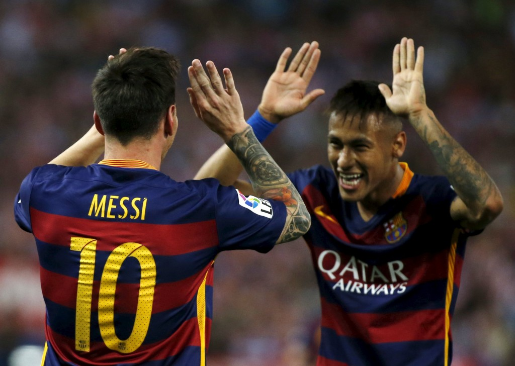 Barcelona's Lionel Messi (L) celebrates with team Neymar after scoring a goal against Atletico Madrid during their Spanish first division soccer match at Vicente Calderon stadium in Madrid,12 September, 2015.REUTERS/Javier Barbancho  Picture Supplied by Action Images