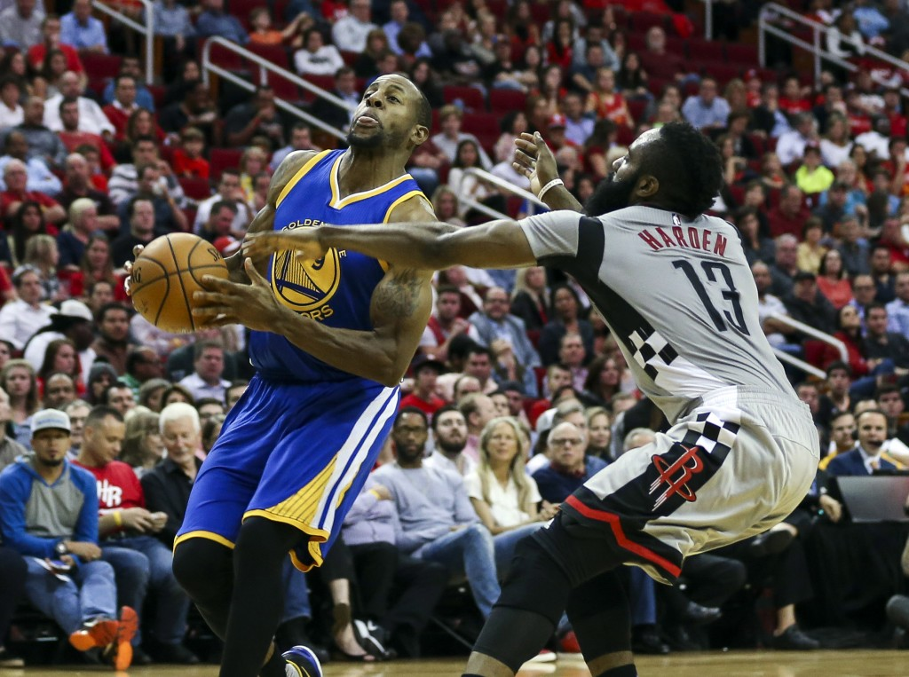 Oct 30, 2015; Houston, TX, USA; Golden State Warriors guard Andre Iguodala (9) takes the ball to the basket during the second quarter as Houston Rockets guard James Harden (13) defends at Toyota Center. Mandatory Credit: Troy Taormina-USA TODAY Sports  / Reuters Picture Supplied by Action Images  (TAGS: Sport Basketball NBA) *** Local Caption *** 2015-10-31T030840Z_6960026_NOCID_RTRMADP_3_NBA-GOLDEN-STATE-WARRIORS-AT-HOUSTON-ROCKETS.JPG