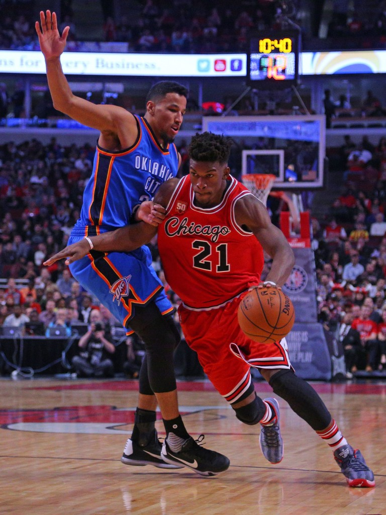 Nov 5, 2015; Chicago, IL, USA; Chicago Bulls guard Jimmy Butler (21) dribble the ball around Oklahoma City Thunder guard Andre Roberson (21) during the second half at the United Center. The Bulls won 104-98. Mandatory Credit: Dennis Wierzbicki-USA TODAY Sports  / Reuters Picture Supplied by Action Images  (TAGS: Sport Basketball NBA) *** Local Caption *** 2015-11-06T040117Z_1408158515_NOCID_RTRMADP_3_NBA-OKLAHOMA-CITY-THUNDER-AT-CHICAGO-BULLS.JPG