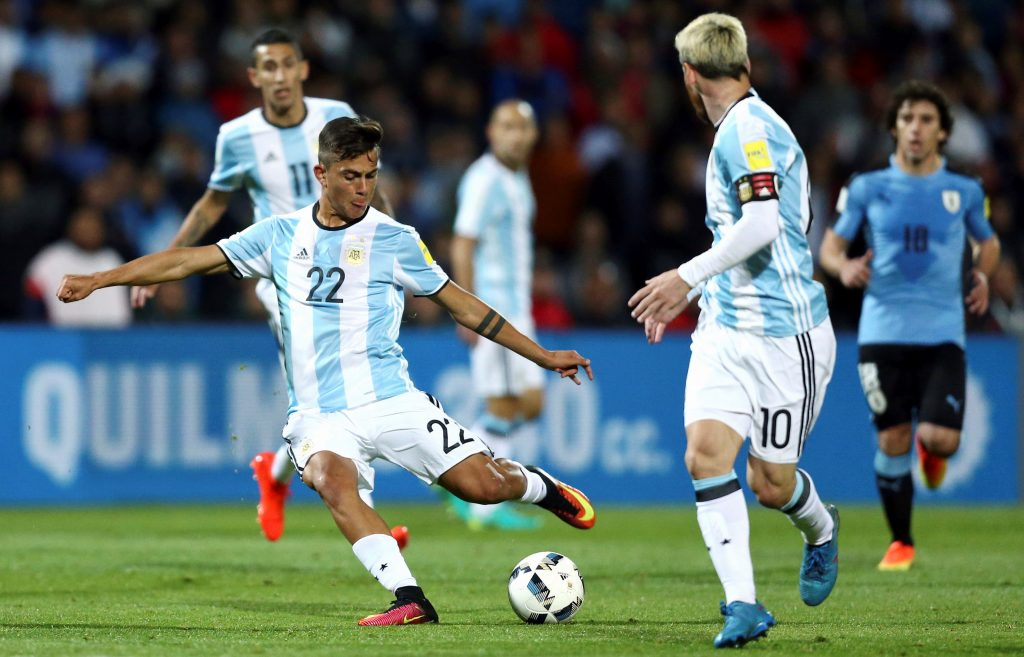 Football Soccer - World Cup 2018 Qualifiers - Argentina v Uruguay - Estadio Malvinas Argentinas, Mendoza, Argentina - 01/09/16 - Argentina's Paulo Dybala shoots next to teammates Lionel Messi and Angel Di Maria (back). REUTERS/Marcos Brindicci  Picture Supplied by Action Images