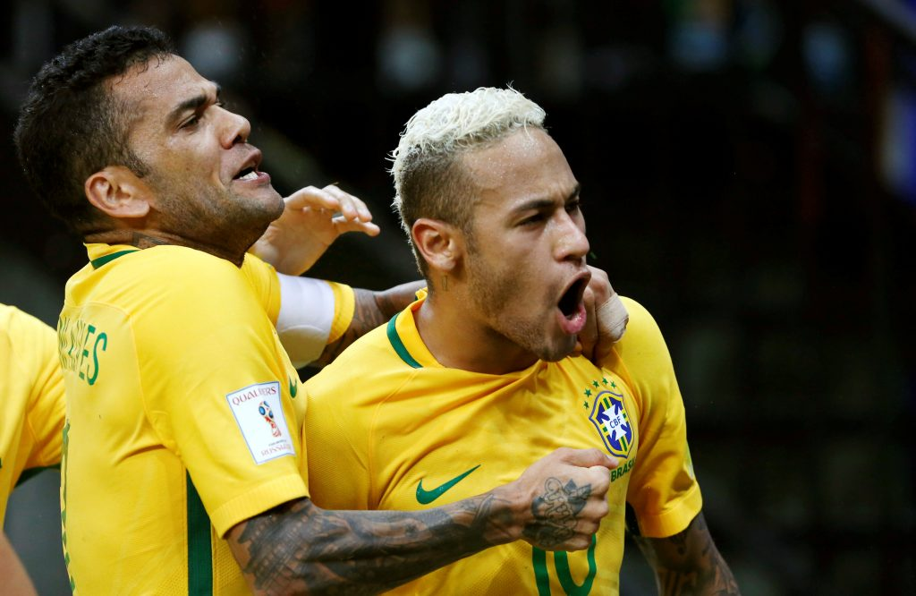Football Soccer - World Cup 2018 Qualifiers - Brazil v Colombia - Amazonia Arena Stadium, Manaus, Brazil - 6/9/16. Neymar (R) of Brazil celebrates with team mate Dani Alves after scoring a goal against Colombia.   REUTERS/Bruno Kelly   Picture Supplied by Action Images