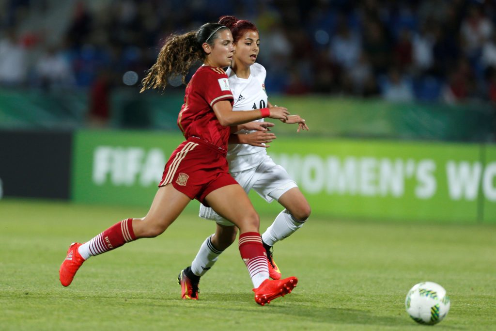 Football Soccer - Jordan vs Spain - U-17 Women's World Cup - Amman, Jordan - 30/9/16 Spain's Berta Pujadas (L), fights for the ball with Jordan's Sarah Abu-Sabbah, during the match. REUTERS/Muhammad Hamed  Picture Supplied by Action Images