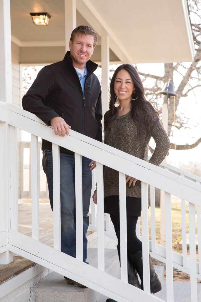 Portrait of Fixer Upper Hosts Chip and Joanna Gaines on the Mahan's new front porch, as seen on HGTV's Fixer Upper.  (portrait)