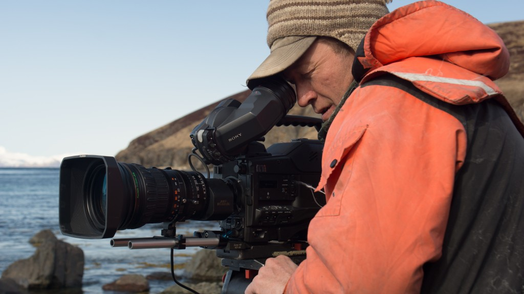 Aleutian Islands, Alaska: Cameraman Shane Moore films on the coast of Alaska. (Photo Credit: National Geographic Television/ Josh Thomas)