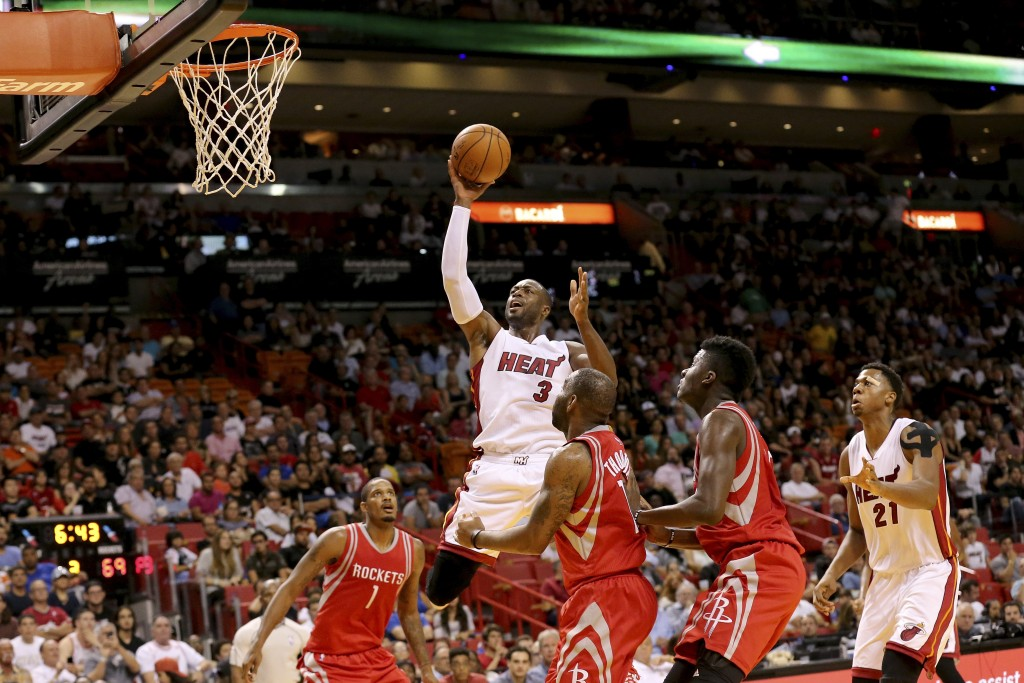 Nov 1, 2015; Miami, FL, USA; Miami Heat guard Dwyane Wade (3) moves to the basket as Houston Rockets guard Marcus Thornton (10) defends during the second half at American Airlines Arena. The Heat won 109-89. Mandatory Credit: Steve Mitchell-USA TODAY Sports  / Reuters Picture Supplied by Action Images  (TAGS: Sport Basketball NBA) *** Local Caption *** 2015-11-02T015701Z_1255220868_NOCID_RTRMADP_3_NBA-HOUSTON-ROCKETS-AT-MIAMI-HEAT.JPG