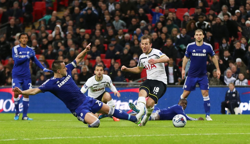 Tottenham's Harry Kane shoots at goal under pressure from Chelsea's John Terry