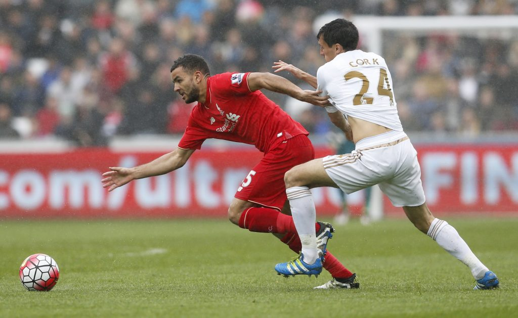 """Britain Football Soccer - Swansea City v Liverpool - Barclays Premier League - Liberty Stadium - 1/5/16 Liverpool's Kevin Stewart in action with Swansea's Jack Cork Action Images via Reuters / Carl Recine Livepic EDITORIAL USE ONLY. No use with unauthorized audio, video, data, fixture lists, club/league logos or """"live"""" services. Online in-match use limited to 45 images, no video emulation. No use in betting, games or single club/league/player publications.  Please contact your account representative for further details."""