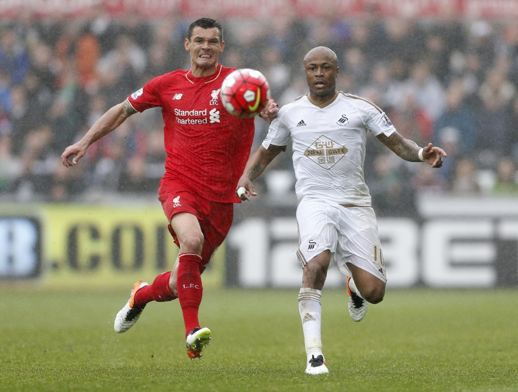 "Britain Football Soccer - Swansea City v Liverpool - Barclays Premier League - Liberty Stadium - 1/5/16 Liverpool's Dejan Lovren in action with Swansea's Andre Ayew Action Images via Reuters / Carl Recine Livepic EDITORIAL USE ONLY. No use with unauthorized audio, video, data, fixture lists, club/league logos or ""live"" services. Online in-match use limited to 45 images, no video emulation. No use in betting, games or single club/league/player publications.  Please contact your account representative for further details."