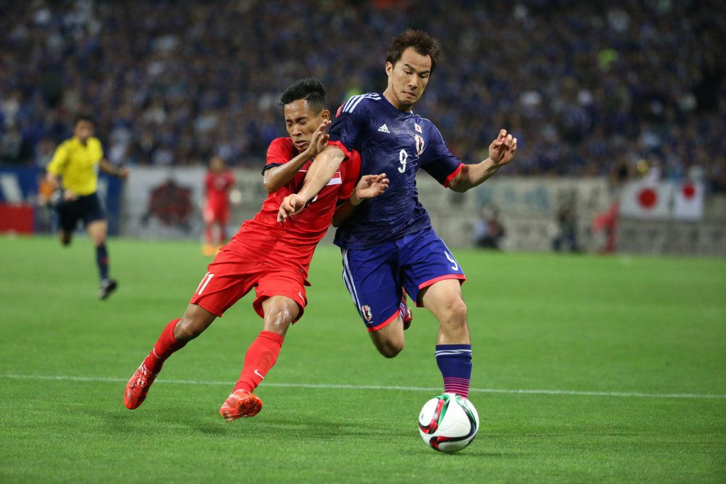(R-L) ‰ªèTŽi/Shinji Okazaki (JPN), Muhammad Nazrul bin Ahmad Nazari (SIN), JUNE 16, 2015 - Football / Soccer : FIFA World Cup Russia 2018 Asian Qualifiers Second round Group E match between Japan 0-0 Singapore at Saitama Stadium 2002 in Saitama, Japan. (Photo by Hitoshi Mochizuki/AFLO)  Picture Supplied by Action Images PLEASE NOTE: FOR EDITORIAL SALES ONLY. CONTRACT CLIENTS: ADDITIONAL FEES MAY APPLY - PLEASE CONTACT YOUR ACCOUNT MANAGER