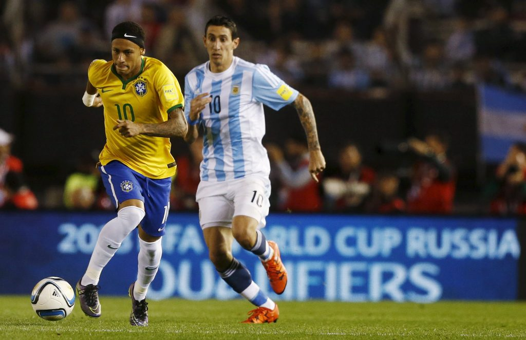 Neymar (L) of Brazil runs with the ball next to Angel Di Maria of Argentina during their 2018 World Cup qualifying soccer match in Buenos Aires, Argentina, November 13, 2015.   REUTERS/Enrique Marcarian    Picture Supplied by Action Images