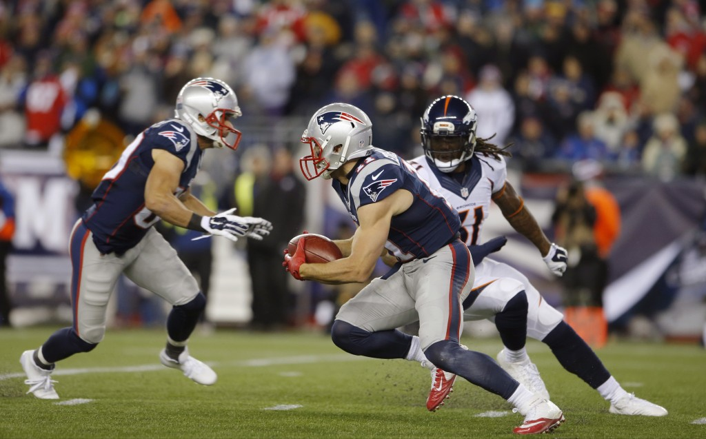 Nov 2, 2014; Foxborough, MA, USA; New England Patriots wide receiver Julian Edelman (11) returns the Denver Broncos punt for a touchdown during the second quarter at Gillette Stadium. Mandatory Credit: David Butler II-USA TODAY Sports  / Reuters Picture Supplied by Action Images  (TAGS: Sport American Football NFL) *** Local Caption *** 2014-11-02T231353Z_41820613_NOCID_RTRMADP_3_NFL-DENVER-BRONCOS-AT-NEW-ENGLAND-PATRIOTS.JPG