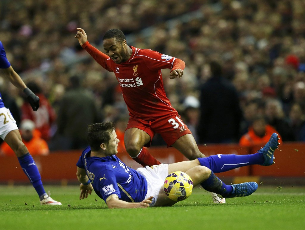 Leicester City's Dean Hammond challenges Liverpool's Raheem Sterling (top) during their English Premier League soccer match at Anfield in Liverpool, northern England January 1, 2015.      REUTERS/Phil Noble (BRITAIN  - Tags: SPORT SOCCER) EDITORIAL USE ONLY. NO USE WITH UNAUTHORIZED AUDIO, VIDEO, DATA, FIXTURE LISTS, CLUB/LEAGUE LOGOS OR 'LIVE' SERVICES. ONLINE IN-MATCH USE LIMITED TO 45 IMAGES, NO VIDEO EMULATION. NO USE IN BETTING, GAMES OR SINGLE CLUB/LEAGUE/PLAYER PUBLICATIONS.FOR EDITORIAL USE ONLY. NOT FOR SALE FOR MARKETING OR ADVERTISING CAMPAIGNS.    Picture Supplied by Action Images