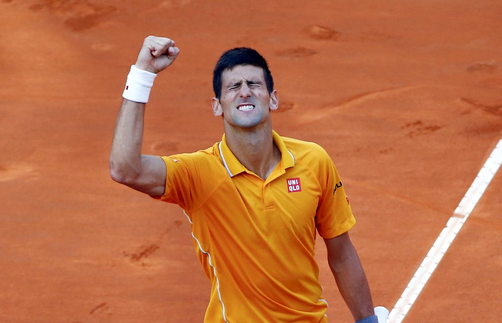 Novak Djokovic of Serbia celebrates winning against Roger Federer of Switzerland after their final match at the Rome Open tennis tournament in Rome, Italy, May 17, 2015. REUTERS/Tony Gentile  Picture Supplied by Action Images