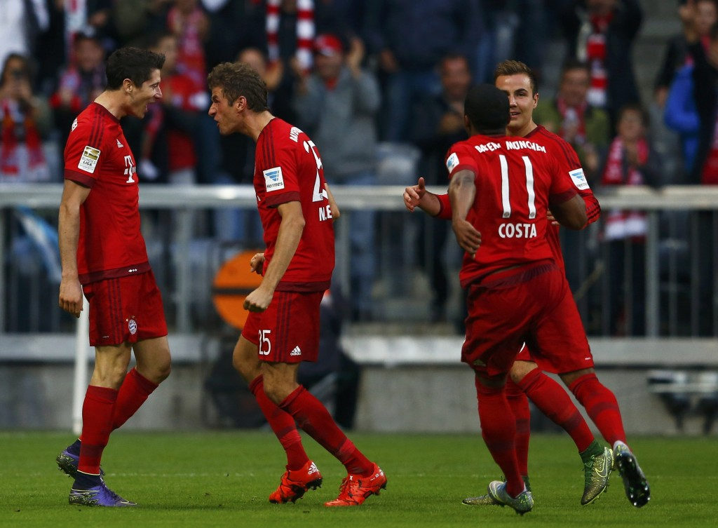 Bayern Munich's Robert Lewandowski (L) celebrates with Thomas Mueller after scoring a goal against Borussia Dortmund during their German first division Bundesliga soccer match in Munich, Germany, October 4, 2015.      REUTERS/Michael Dalder    DFL RULES TO LIMIT THE ONLINE USAGE DURING MATCH TIME TO 15 PICTURES PER GAME. IMAGE SEQUENCES TO SIMULATE VIDEO IS NOT ALLOWED AT ANY TIME. FOR FURTHER QUERIES PLEASE CONTACT DFL DIRECTLY AT + 49 69 650050.    Picture Supplied by Action Images