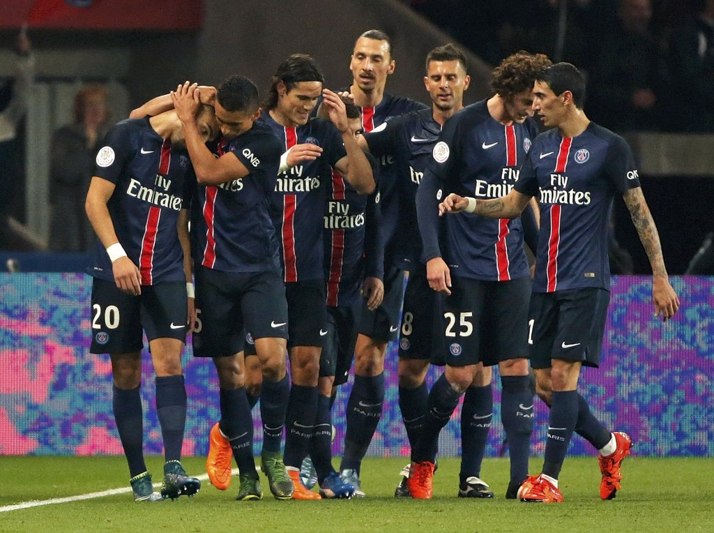 Paris St Germain's Layvin Kurzawa (L) is congratulated by his team mates after his goal against Saint-Etienne during their French Ligue 1 soccer match at the Parc des Princes stadium in Paris, France, October 25, 2015.  REUTERS/Christian Hartmann  Picture Supplied by Action Images