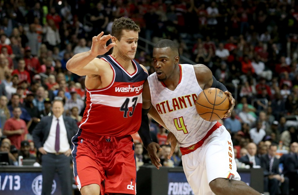 Nov 7, 2015; Atlanta, GA, USA; Atlanta Hawks forward Paul Millsap (4) drives against Washington Wizards forward Kris Humphries (43) in the fourth quarter of their game at Philips Arena. The Hawks won 114-99. Mandatory Credit: Jason Getz-USA TODAY Sports  / Reuters Picture Supplied by Action Images  (TAGS: Sport Basketball NBA) *** Local Caption *** 2015-11-08T041821Z_1323881647_NOCID_RTRMADP_3_NBA-WASHINGTON-WIZARDS-AT-ATLANTA-HAWKS.JPG