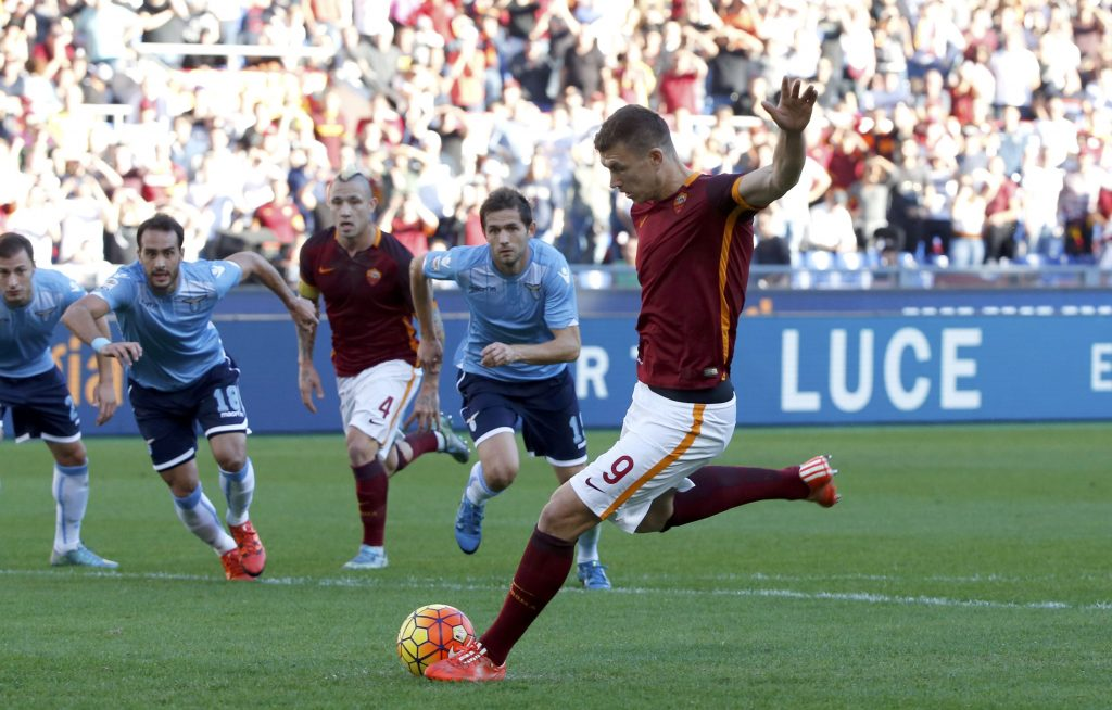 AS Roma's Edin Dzeko shoot and scores a penalty kick against Lazio's during their Serie A soccer match at Olympic stadium in Rome, Italy, November 8, 2015. REUTERS/Alessandro Bianchi  Picture Supplied by Action Images