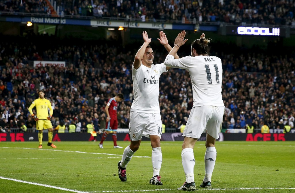Football Soccer - Real Madrid v Real Sociedad - Spanish Liga BBVA - Santiago Bernabeu stadium, Madrid, Spain - 30/12/15 Real Madrid's Lucas Vazquez celebrates with his team mate Gareth Bale (R) his first  goal REUTERS/Juan Medina  Picture Supplied by Action Images