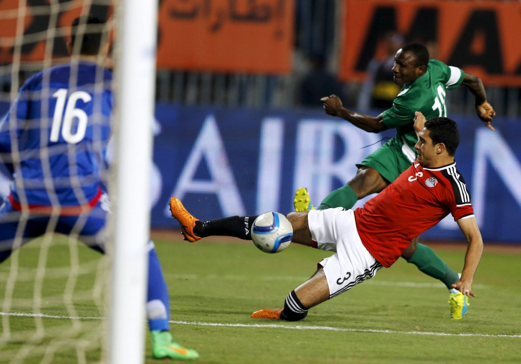 Football Soccer - African Nations Cup qualifiers – Group G – Egypt  v Nigeria - Borg El Arab Stadium, Alexandria, Egypt - 29/03/2016 - Egypt's Rami Rabia and Nigeria's Aminu Umar in action. REUTERS/Amr Abdallah Dalsh  Picture Supplied by Action Images