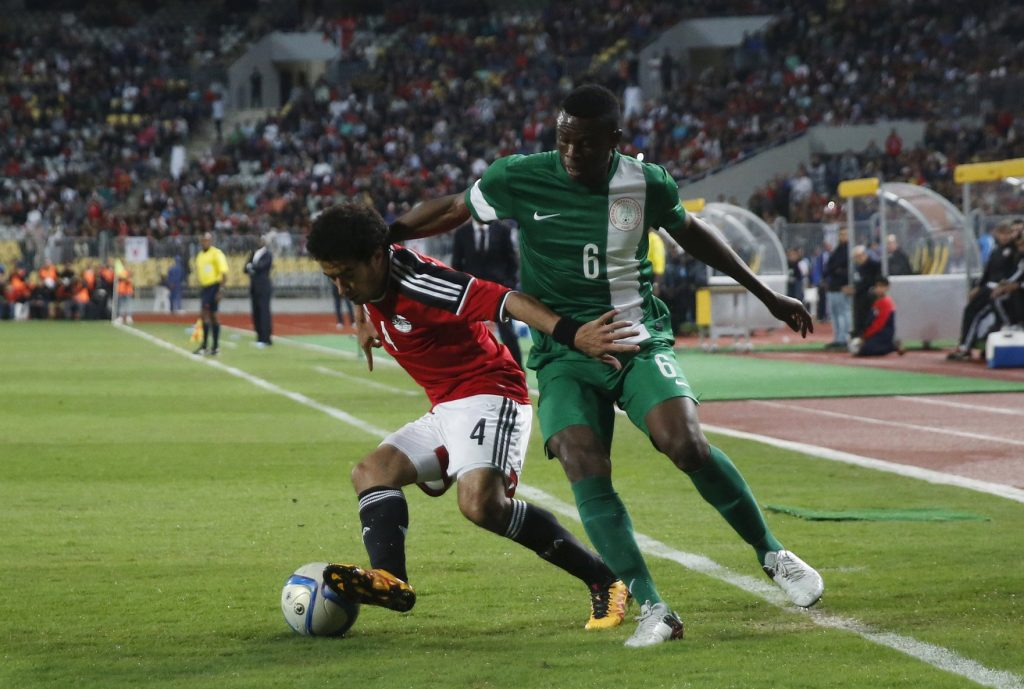 Football Soccer - African Nations Cup qualifiers – Group G – Egypt  v Nigeria - Borg El Arab Stadium, Alexandria, Egypt - 29/03/2016 - Egypt's Omar Gaber and Nigeria's Stanley Amuzie in action. REUTERS/Amr Abdallah Dalsh  Picture Supplied by Action Images