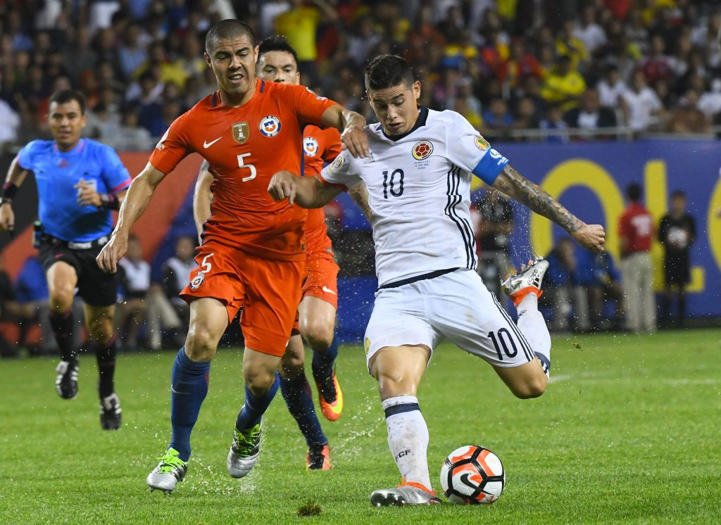 Jun 22, 2016; Chicago, IL, USA; Colombia midfielder James Rodriguez (10) kicks the ball against Chile midfielder Francisco Silva (5) during the second half in the semifinals of the 2016 Copa America Centenario soccer tournament at Soldier Field. Chile defeated Colombia 2-0. Mandatory Credit: Mike DiNovo-USA TODAY Sports  / Reuters Picture Supplied by Action Images *** Local Caption *** 2016-06-23T050547Z_1877639347_NOCID_RTRMADP_3_SOCCER-2016-COPA-AMERICA-CENTENARIO-COLOMBIA-AT-CHILE.JPG
